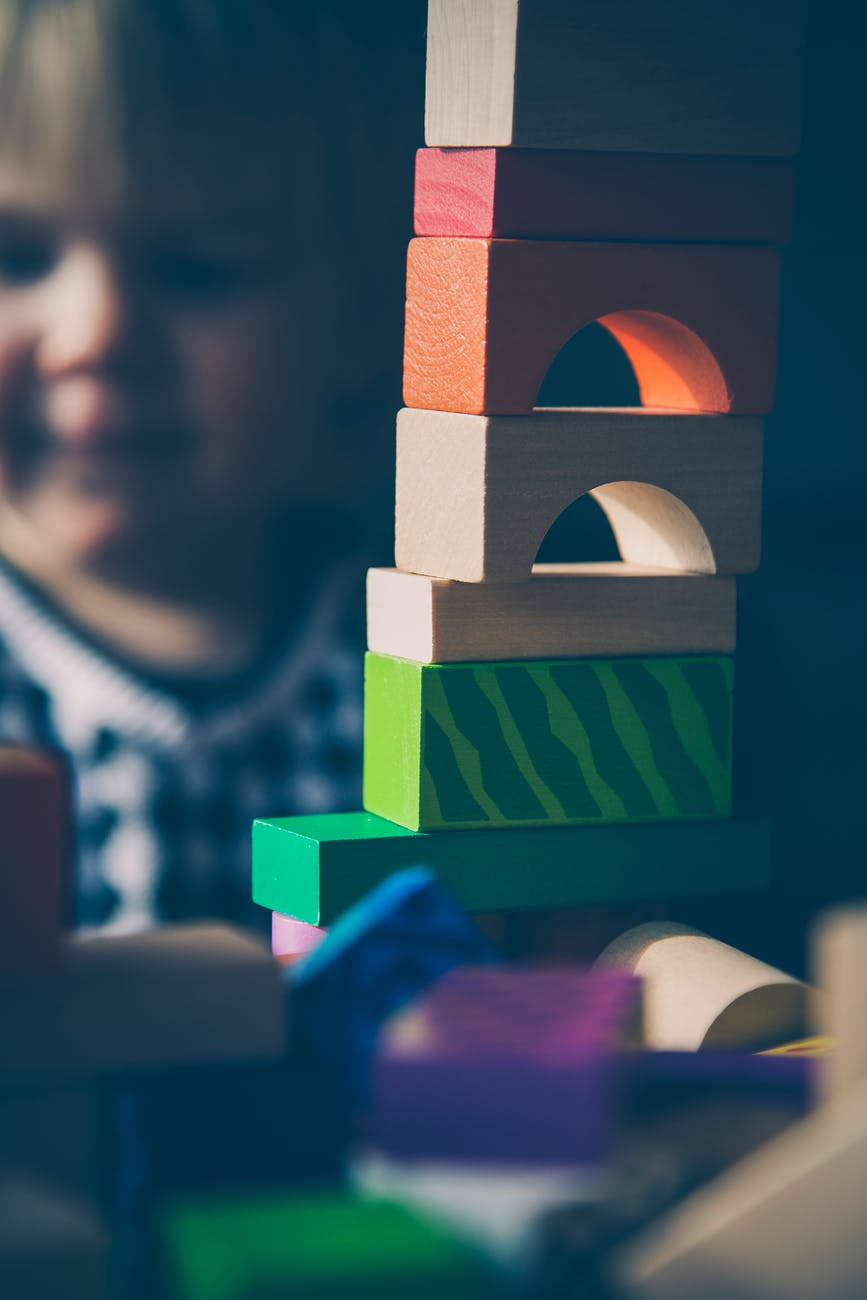 Stack of blocks with baby in background